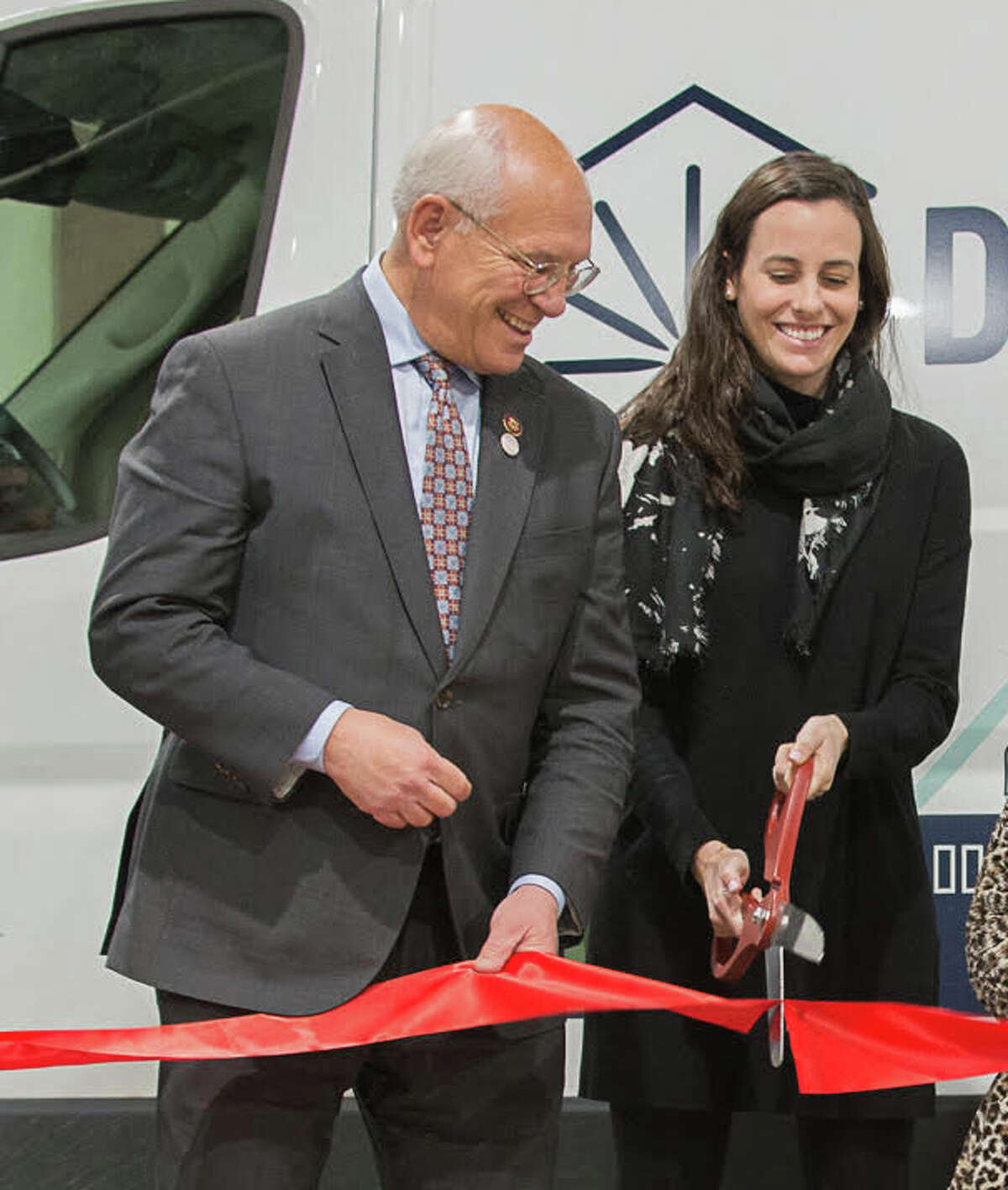 (L) U.S. Rep. Paul Tonko, D-Amsterdam, cuts the ribbon on an expanded operation center for Dandelion Energy in Latham, N.Y. with the company's president and co-founder Kathy Hannun (R) in November 2019. Tonko has chosen Hannun to be his guest at the State of the Union address in Washington, D.C. on Tuesday February 4, 2020.