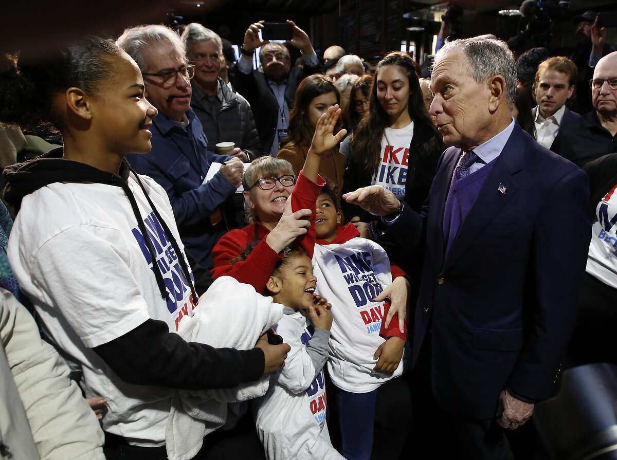 Democratic presidential candidate and former New York City Mayor Michael Bloomberg, right, talks with supporters during a campaign stop in Sacramento, Calif., Monday, Feb. 3, 2020. (AP Photo/Rich Pedroncelli)