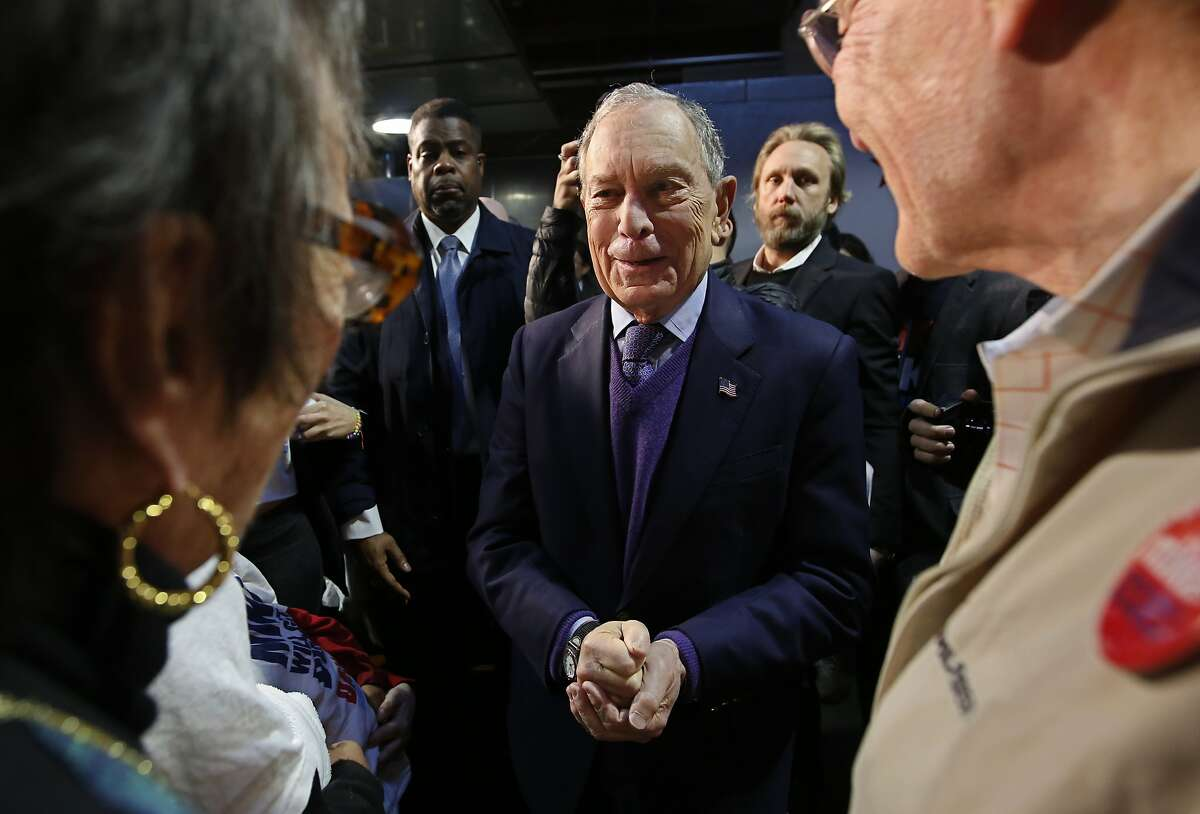 Democratic presidential candidate and former New York City Mayor Michael Bloomberg talks with supporters during a campaign stop in Sacramento, Calif., Monday, Feb. 3, 2020. (AP Photo/Rich Pedroncelli)
