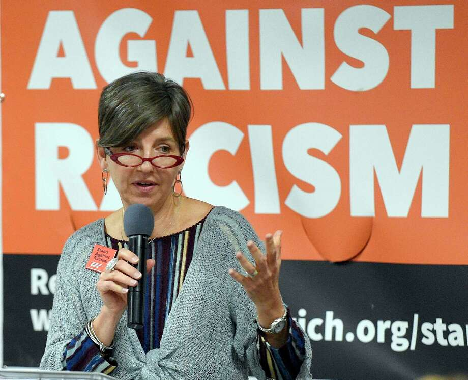 Claudia Connor, president & CEO of the Connecticut Institute for Refugees and Immigrant, addresses the audience at the Stand Against Racism rally at Greenwich Town Hall earlier this year. Photo: Hearst Connecticut Media File Photo / Stamford Advocate