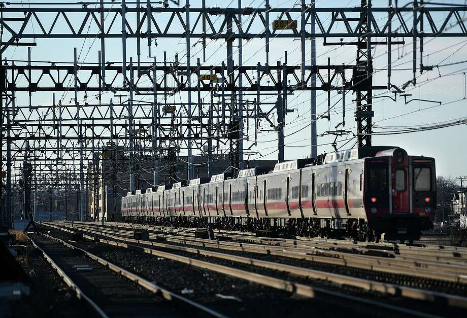 A New York bound Metro-North train heads across the East Side of Bridgeport. Photo: Brian A. Pounds / Hearst Connecticut Media / Connecticut Post