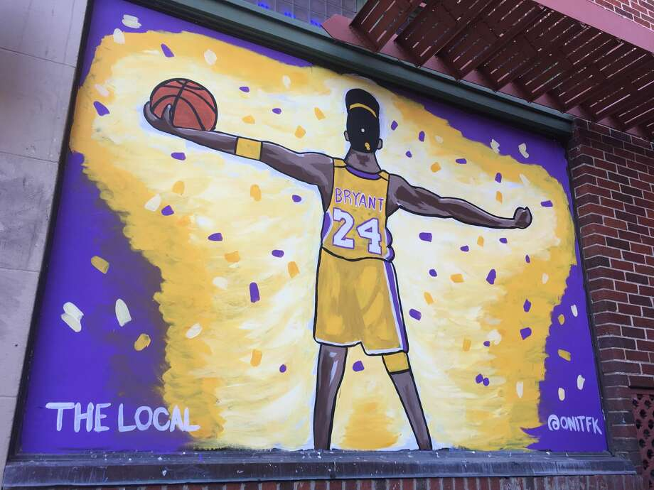 The Local Bar, at 600 N. Presa, tapped artist Faustin Deleon, or @onitfk, to create a piece to cover one of the bar's windows. The art was completed Saturday and depicts Bryant celebrating his last NBA Championship in 2010. Photo: Courtesy, Luis Munoz