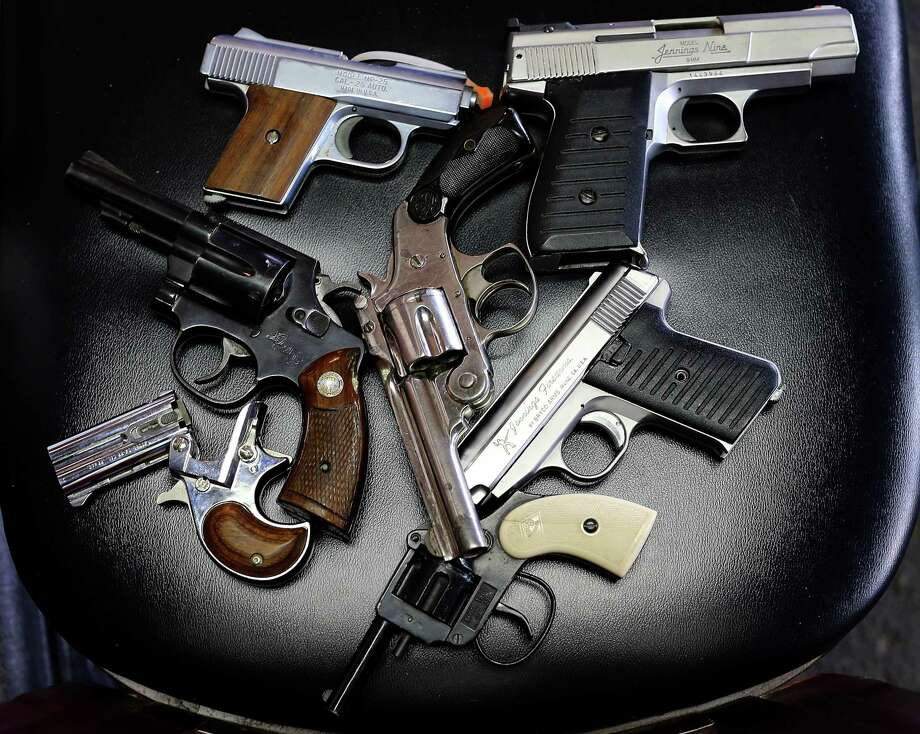 A detail view of pistols that were turned in during a gun buy back program in 2013. Photo: Tom Pennington / Getty Images / 2013 Getty Images