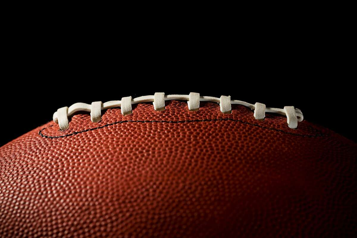 Football on black background. Stock photo