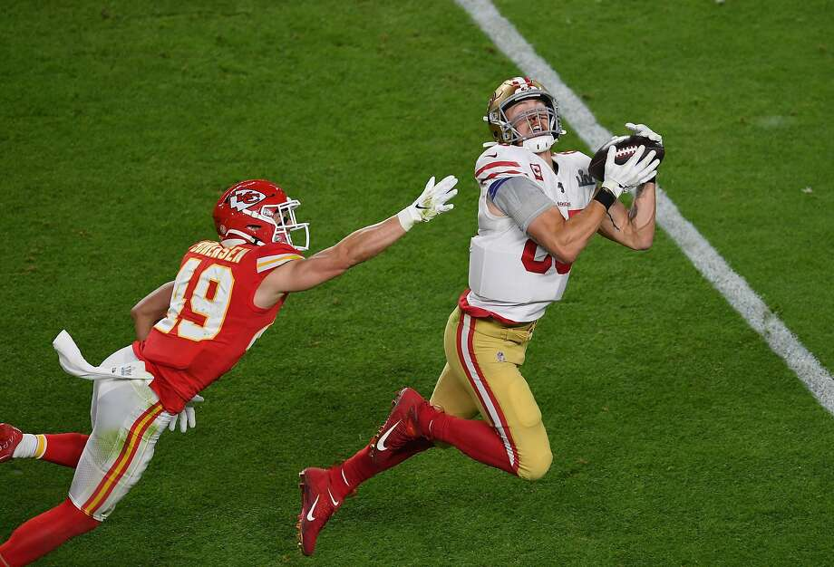 Free safety for the Kansas City Chiefs Daniel Sorensen (L) tries to block San Francisco 49ers tight end George Kittle from catching the ball during Super Bowl LIV between the Kansas City Chiefs and the San Francisco 49ers at Hard Rock Stadium in Miami Gardens, Florida, on February 2, 2020. Photo: Angela Weiss, AFP Via Getty Images