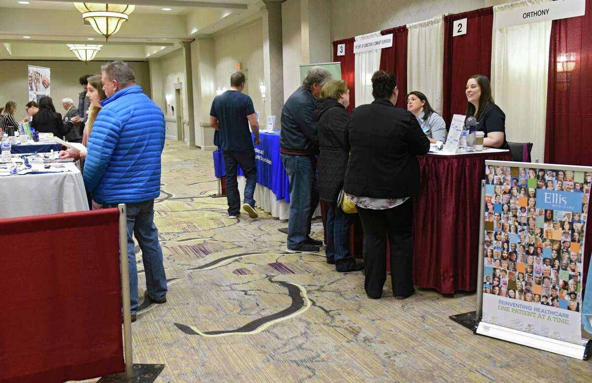 Job seekers talk to representatives at the annual health careers job fair at the Albany Marriott Hotel on Monday, Feb. 3, 2020 in Colonie, N.Y. (Lori Van Buren/Times Union)