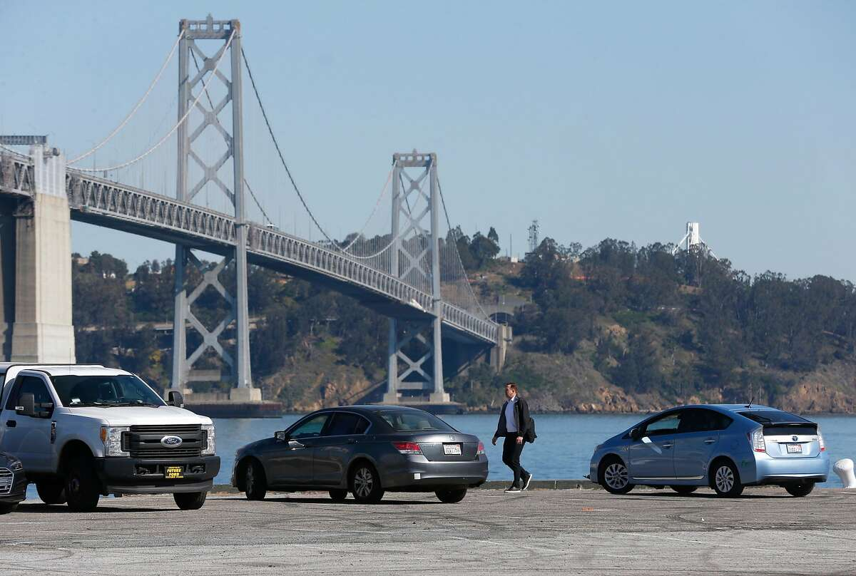 A man walks on Piers 30-32 in San Francisco, Calif. on Wednesday, Feb. 21, 2018 where a number of redevelopment projects have been proposed.