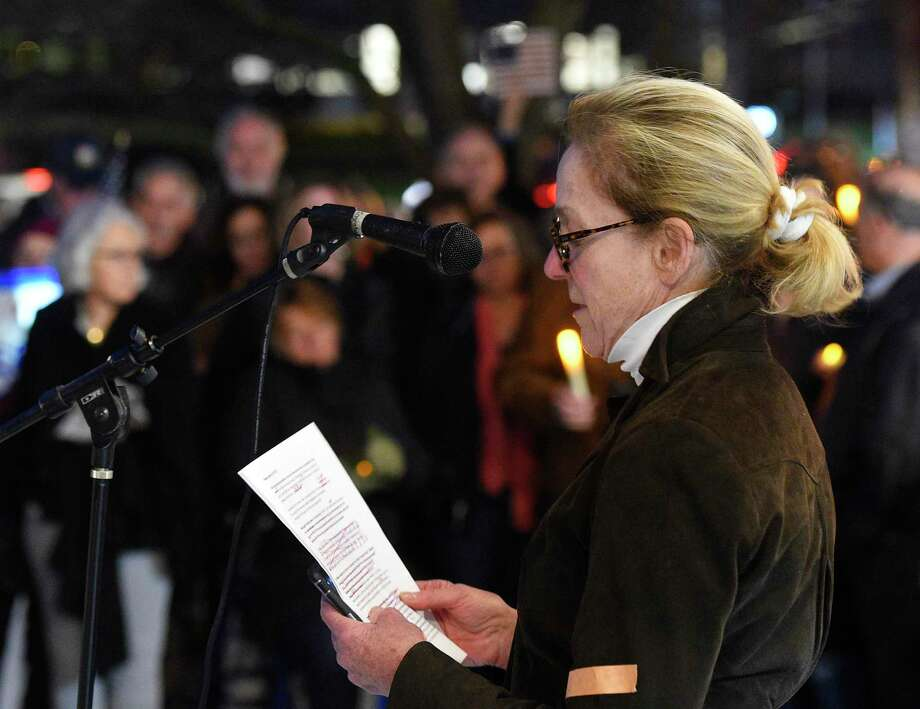 "Indivisible co-founder Joanna Swomley speaks at the Indivisible Greenwich rally against the firing of Attorney General Jeff Sessions outside Town Hall in Greenwich, Conn. Thursday, Nov. 8, 2018. Indivisible Greenwich, a group ""dedicated to fighting the anti-democratic actions and policies of the Trump Administration,"" claims President Trump crossed a line by firing Jeff Sessions and potentially interfering with the Mueller investigation. The rally in Greenwich was one of 14 in Connecticut and about 900 nationally. Photo: Tyler Sizemore / Hearst Connecticut Media / Greenwich Time"