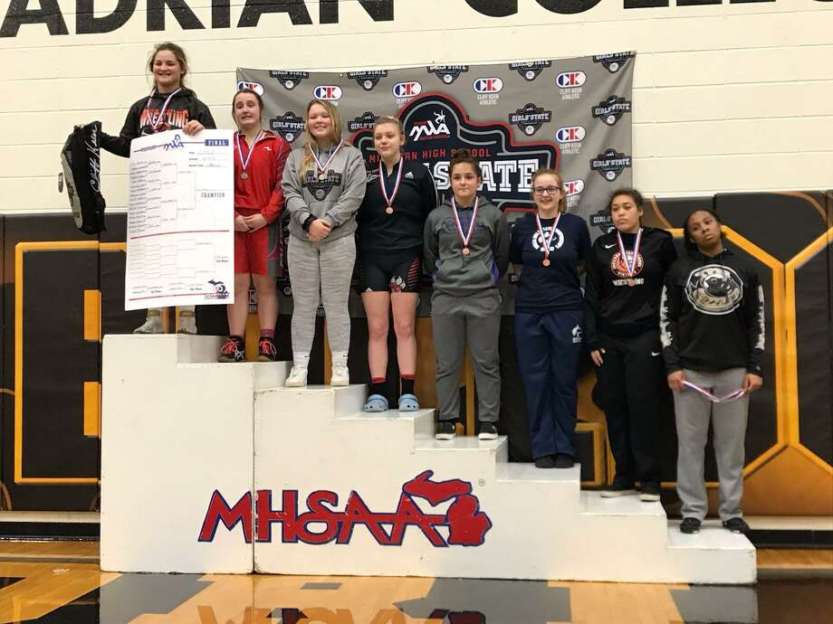 Briellen Clapp and her fellow state medalists are honored on the podium. Photo: Courtesy Photo/Jaime Smith