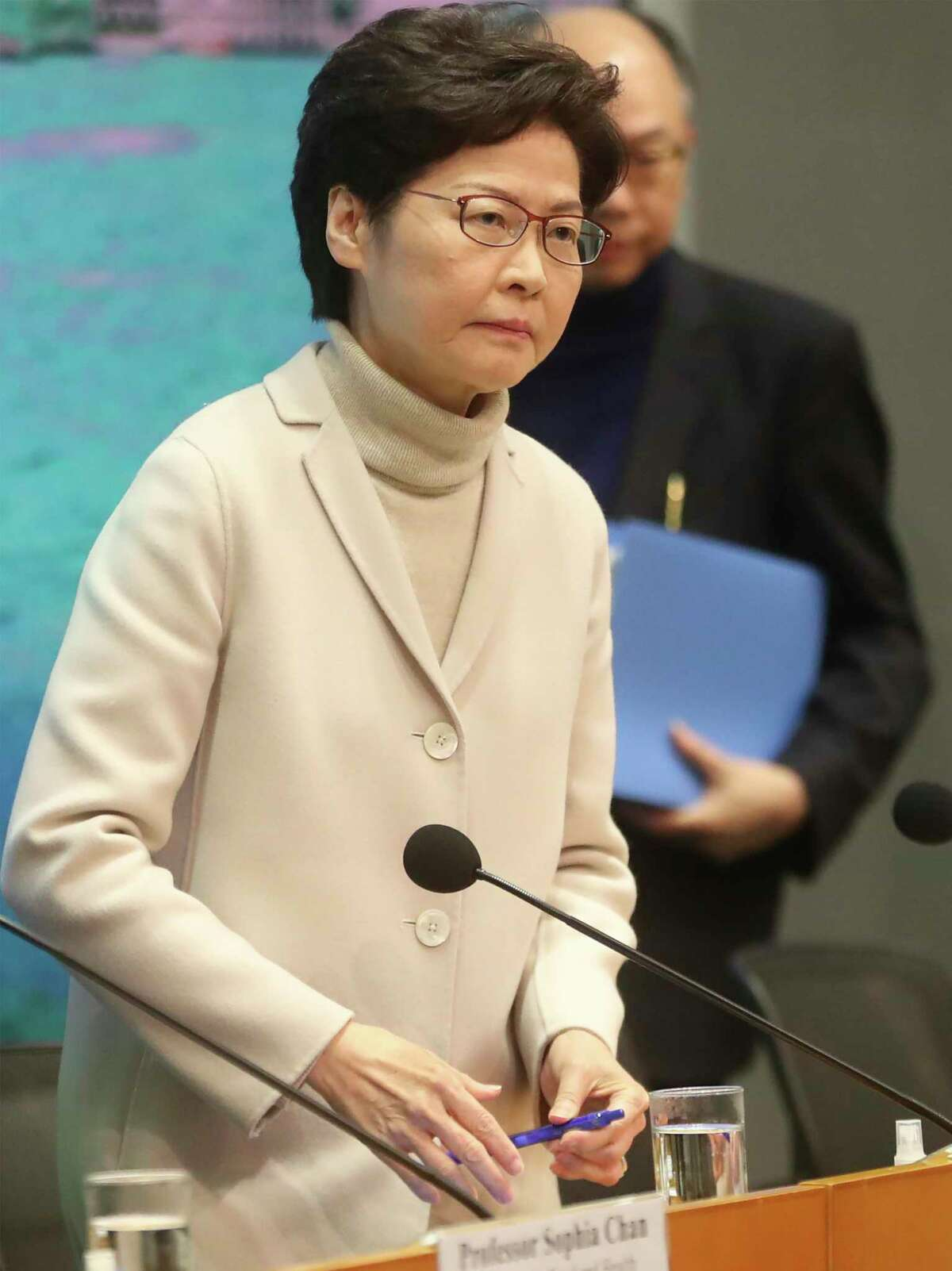 Hong Kong Chief Executive Carrie Lam prepare for a press conference in Hong Kong, Monday, Feb 3, 2020. Lam says the city will shut almost all land and sea border control points to the mainland from midnight to stem the spread of the novel coronavirus from China. (AP Photo/Achmad Ibrahim)