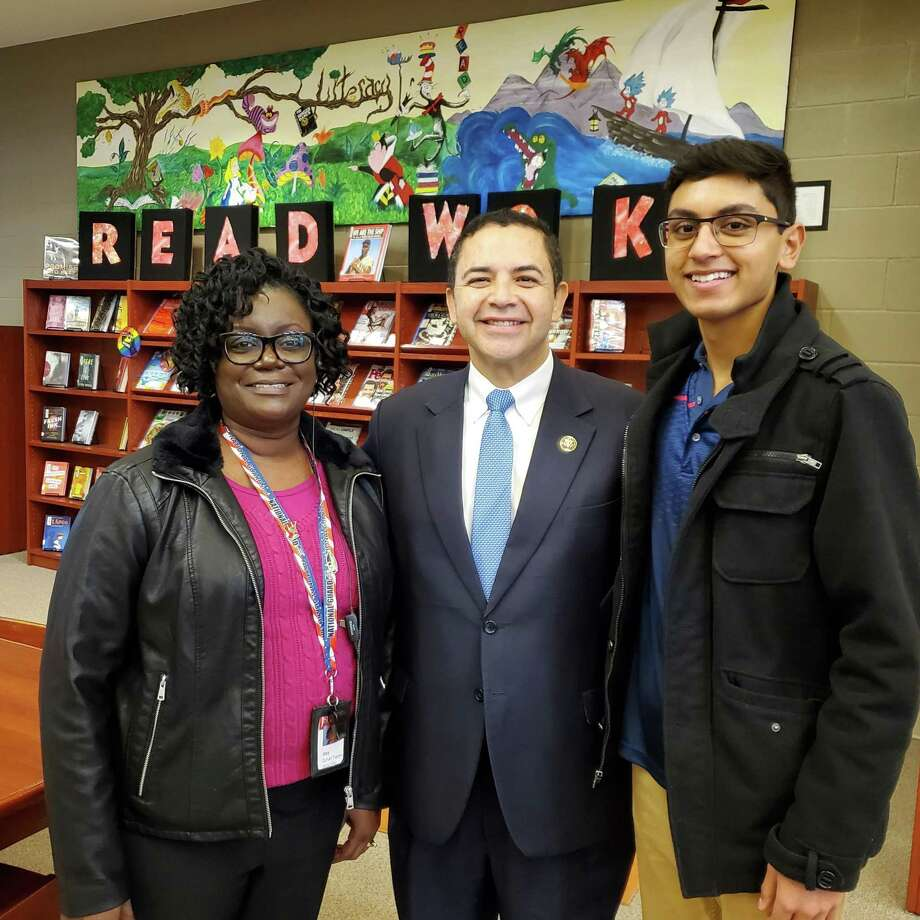 Ian Fernandes, right, a Wagner High School junior, is a 2019 Congressional App Challenge winner, as awarded Jan. 22 by U.S. Rep. Henry Cuellar (D-Texas) and Wagner Principal Mary Duhart-Toppen, left. Photo: Jeff B. Flinn /Staff