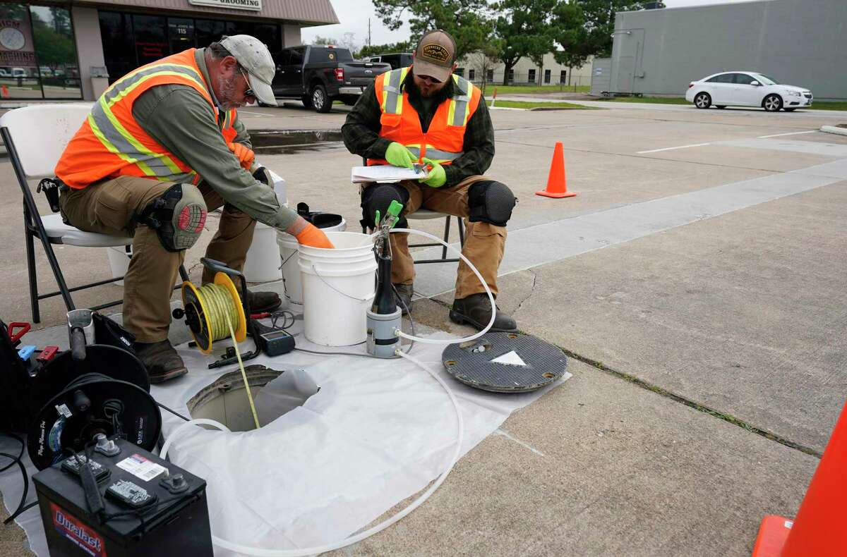 EPA contractors in the parking lot of Cypress Centre, 11600 Jones Road, conduct testing at the Jones Road Ground Water Plume Superfund Site Wednesday, Jan. 29, 2020, in Houston. The area was contaminated with tetrachloroethylene from the former Bell Dry Cleaners located at the shopping center.