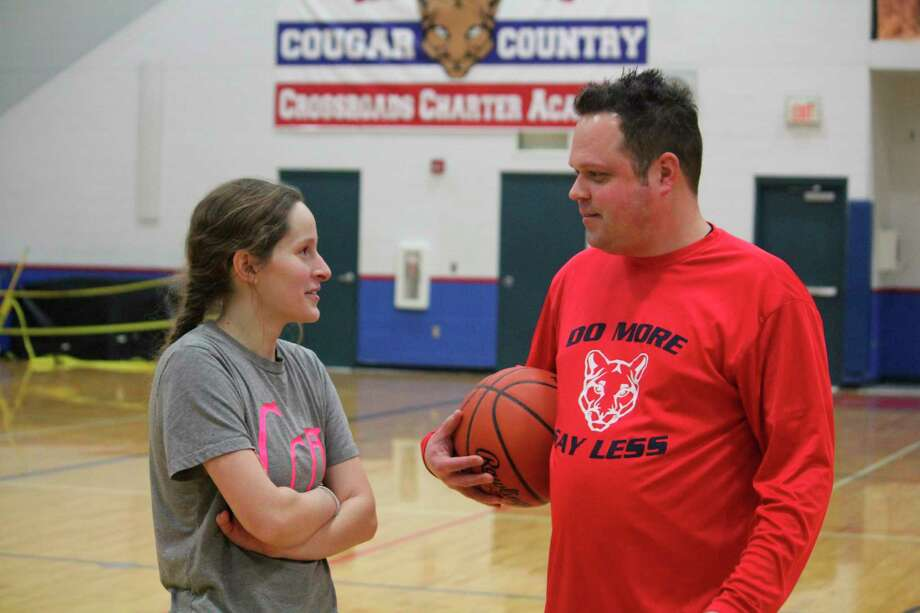 Jozlyn West (left) and Crossroads coach Jason Kostecki discuss Tuesday's girls basketball game with Mason County Eastern after a Monday practice. (Pioneer photo/John Raffel)