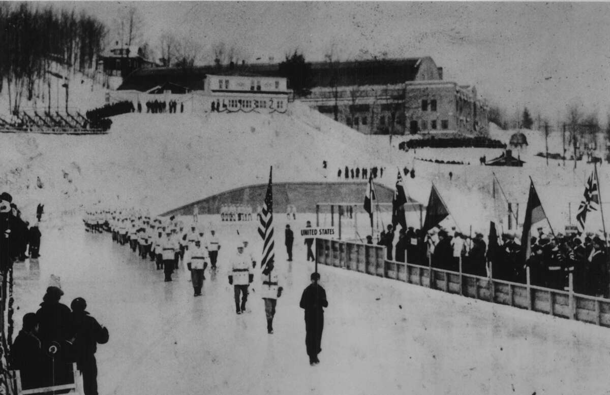 The United States team marches at the opening ceremonies of the III Winter Olympics on Feb., 4, 1932, at Lake Placid. The event marked the first time road salt was used in great quantities in the region - despite the fact that the anticipated snowfall never arrived. (Times Union Archive)