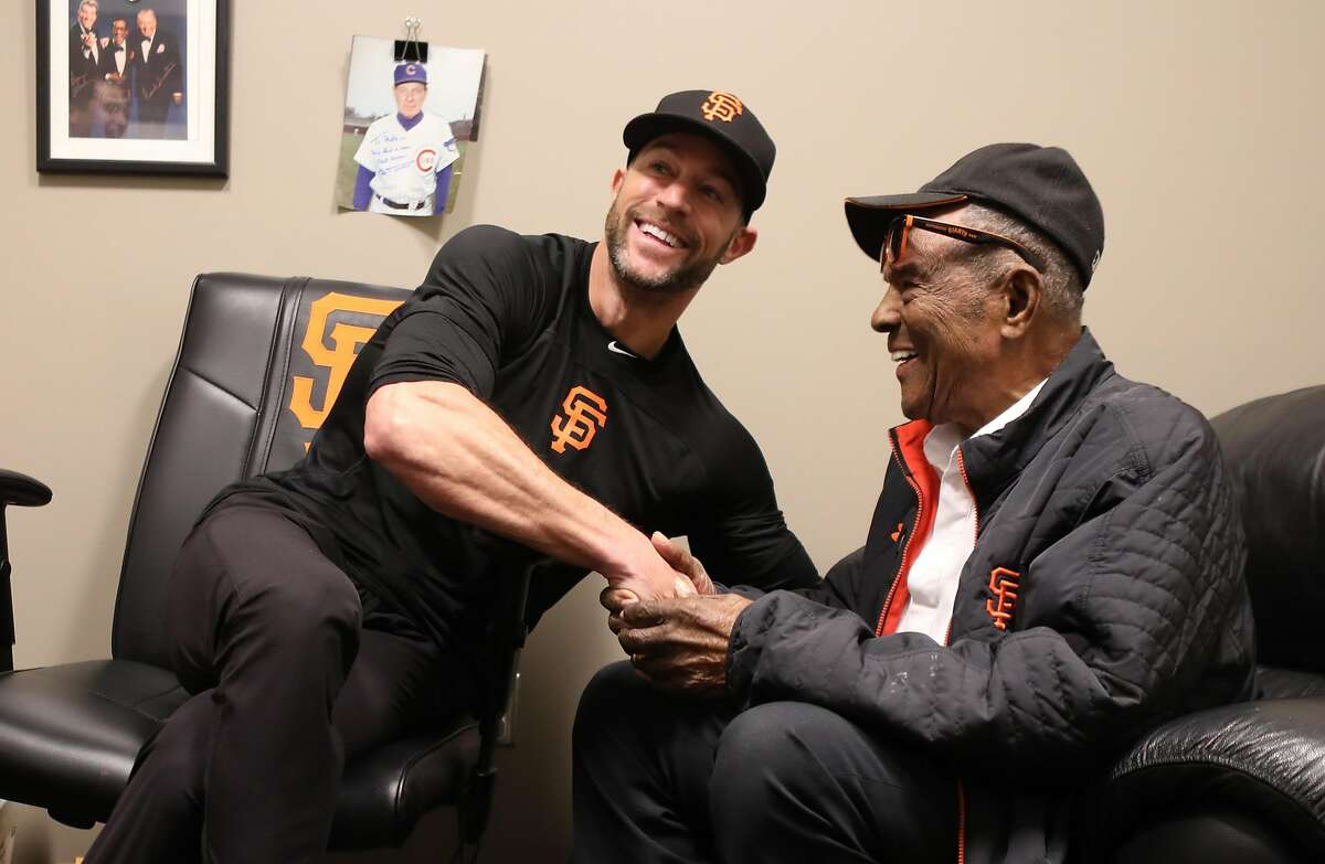 New Giants manager Gabe Kapler (left) meets with Willie Mays (right) for the first time at the AT&T ball park on Monday, Feb. 3, 2020, in San Francisco, Calif.