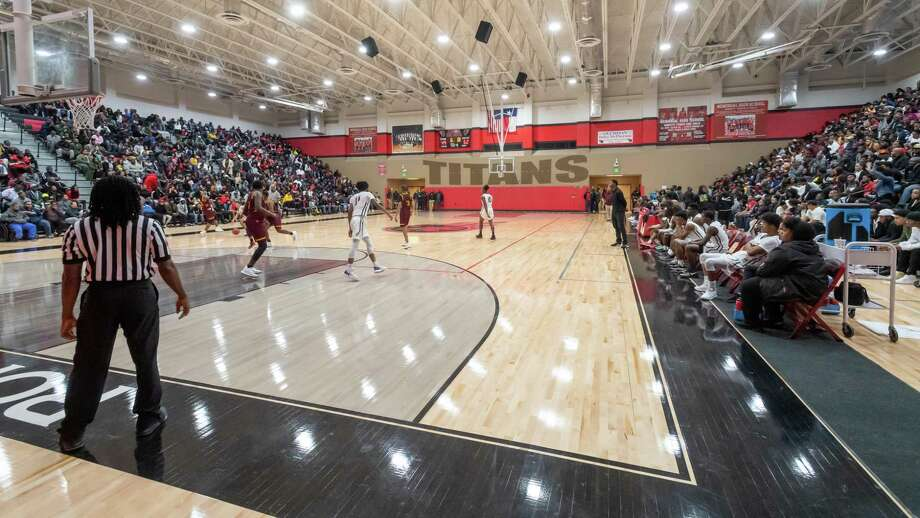 The gym at Port Arthur Memorial High School was filled to capacity and it was rocking and rolling as the Titans took on the Timberwolves of Beaumont United on Friday night, December 20, 2019. Fran Ruchalski/The Enterprise Photo: Fran Ruchalski/The Enterprise