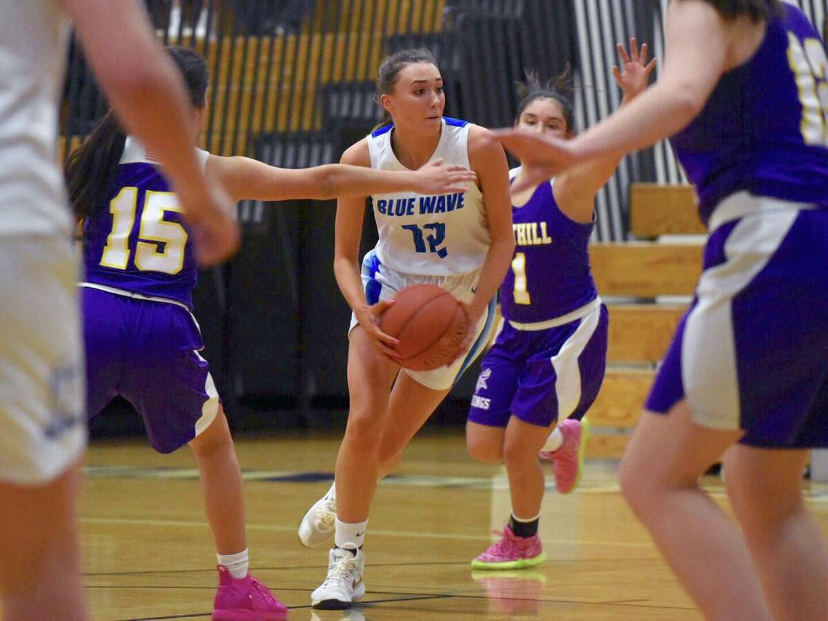 Darien's Lindsay Dimonekas (12) drives for a basket during a girls basketball game against Westhill at Darien High School on Monday, Feb. 3, 2020.