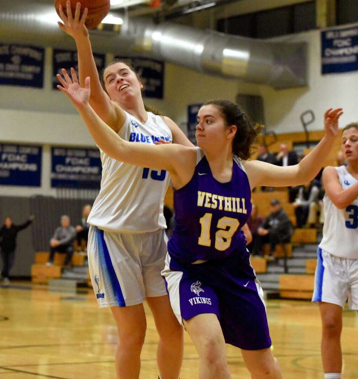 Darien's Shea Dolce (13) and Westhill's Caroline Kollar (12) battle for a rebound during a girls basketball game at Darien High School on Monday, Feb. 3, 2020.