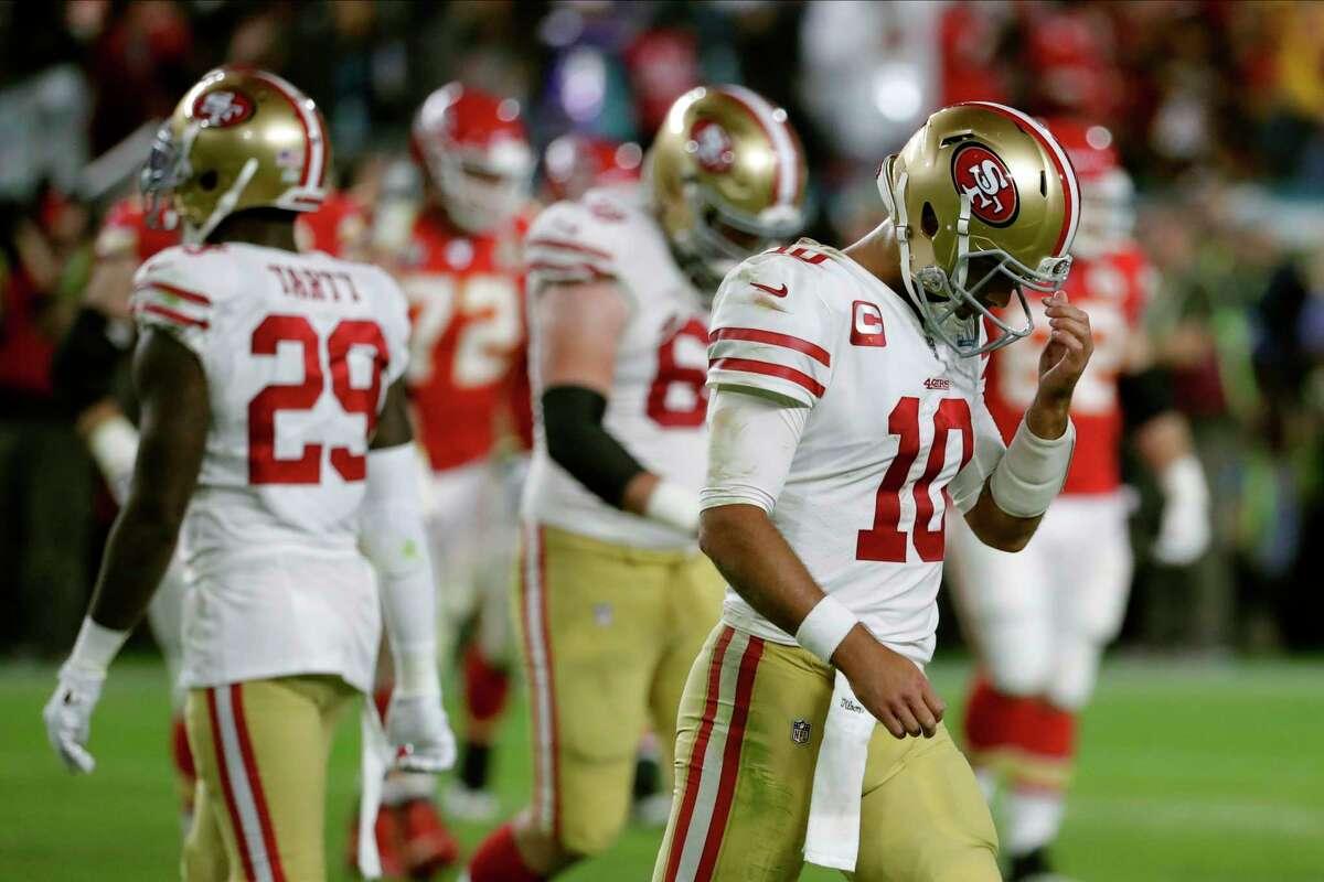 San Francisco 49ers quarterback Jimmy Garoppolo walks to the sideline during the second half of the NFL Super Bowl 54 football game against the Kansas City Chiefs Sunday, Feb. 2, 2020, in Miami Gardens, Fla. (AP Photo/Matt York)