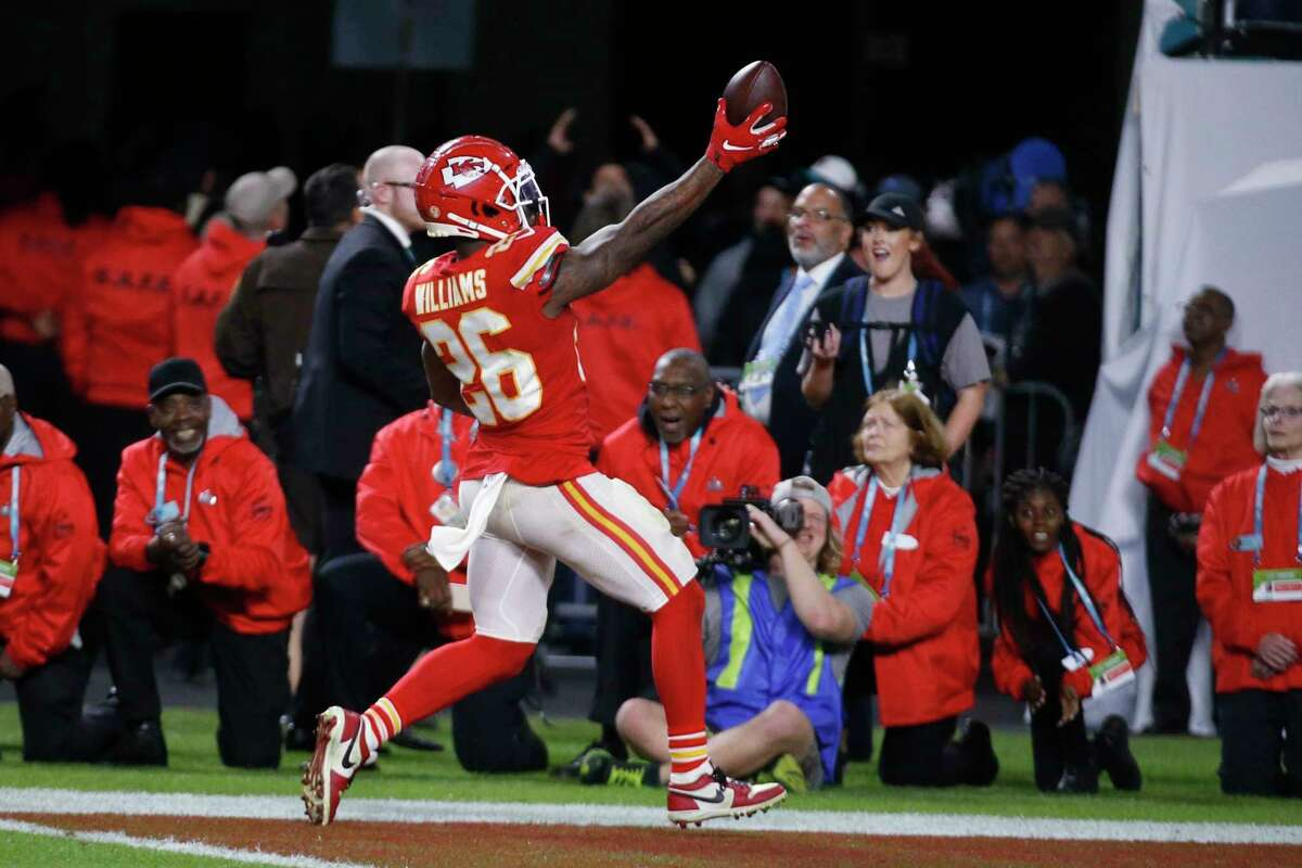Kansas City Chiefs' Damien Williams (26) scores a touchdown, during the second half of the NFL Super Bowl 54 football game Sunday, Feb. 2, 2020, in Miami Gardens, Fla. (AP Photo/Mark Humphrey)