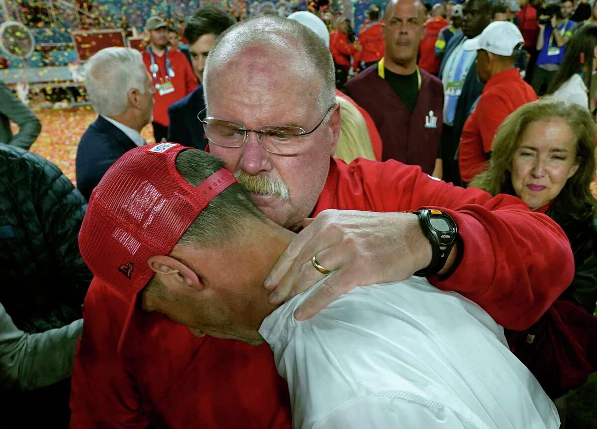 Kansas City Chiefs head coach Andy Reid, rear, puts his arm around San Francisco 49ers head coach Kyle Shanahan after the Chiefs defeated the 49ers in the NFL Super Bowl 54 football game Sunday, Feb. 2, 2020, in Miami Gardens, Fla. (AP Photo/David J. Phillip)