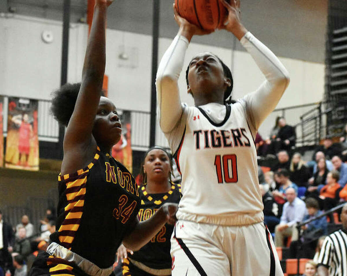 Edwardsville senior forward Amanda Mills puts up a contested shot in the first quarter.