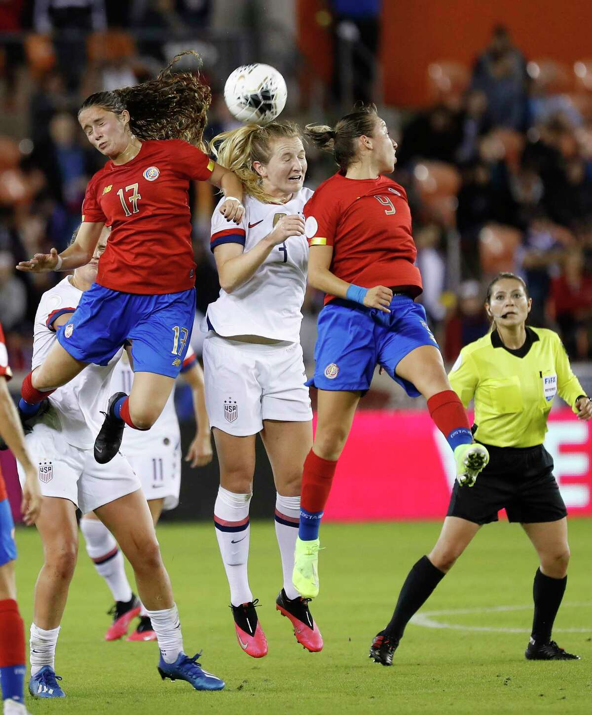 U.S. midfielder Samantha Mewis (3) heads the ball with Costa Rica forward Maria Salas (17) and Costa Rica midfielder Gloriana Villalobos (9) during the first half of the 2020 Concacaf Women's Olympic Qualifying between the United States and Costa Rica at BBVA Stadium in Houston, Monday, Feb. 3, 2020.