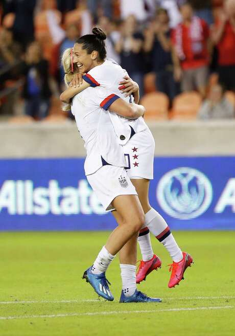 U.S. forward Christen Press (20) celebrates her goal with midfielder Lindsey Horan (9) during the first half of the 2020 Concacaf Women's Olympic Qualifying between the United States and Costa Rica at BBVA Stadium in Houston, Monday, Feb. 3, 2020.