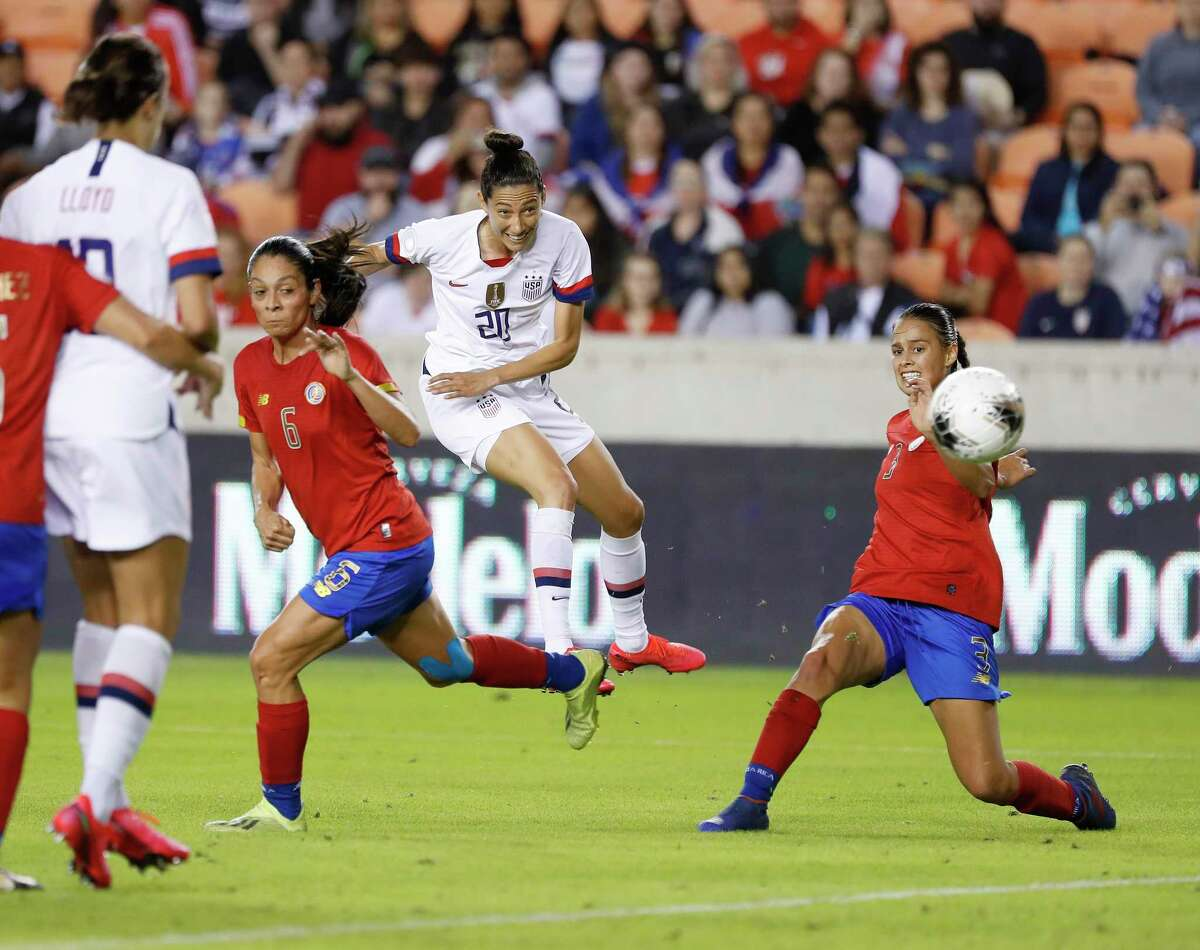 U.S. forward Christen Press (20) shoots the ball into the goal between Costa Rica defenders Carol Sanchez (6) and Maria Coto (3) during the first half of the 2020 Concacaf Women's Olympic Qualifying between the United States and Costa Rica at BBVA Stadium in Houston, Monday, Feb. 3, 2020.