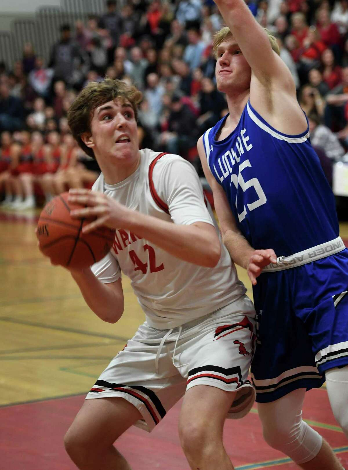 Warde's Jack McKenna looks to score inside defended by Ludlowe's Rowan Keeser in the first half of their boys basketball matchup for Coaches vs. Cancer at Warde High School in Fairfield, Conn. on Monday, February 03, 2020.