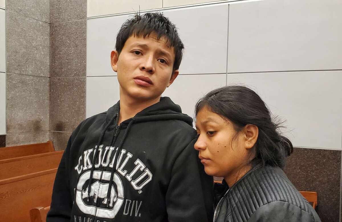 Jefrey Xavier Aguilar (left) andSiara Sanchez (right) appear Monday in the314th Juvenile Court for a Child Protective Services hearing. The agency last week removed their children from a home where a man severely abused his 2-year-old nephew, officials said.