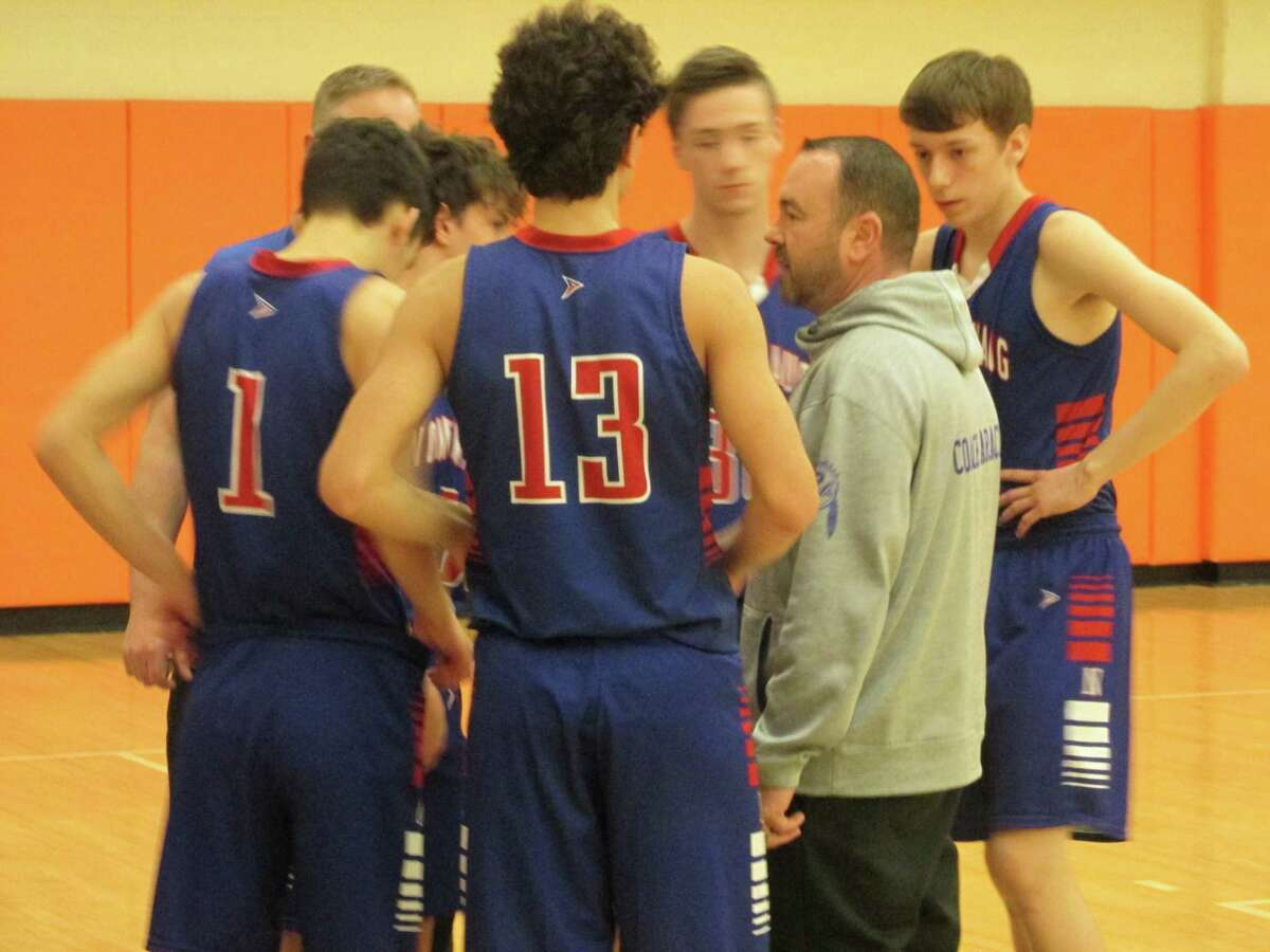 Nonnewaug coach Rich Feraci keeps his team calm in an important win for the Chiefs at Terryville High School Monday night.