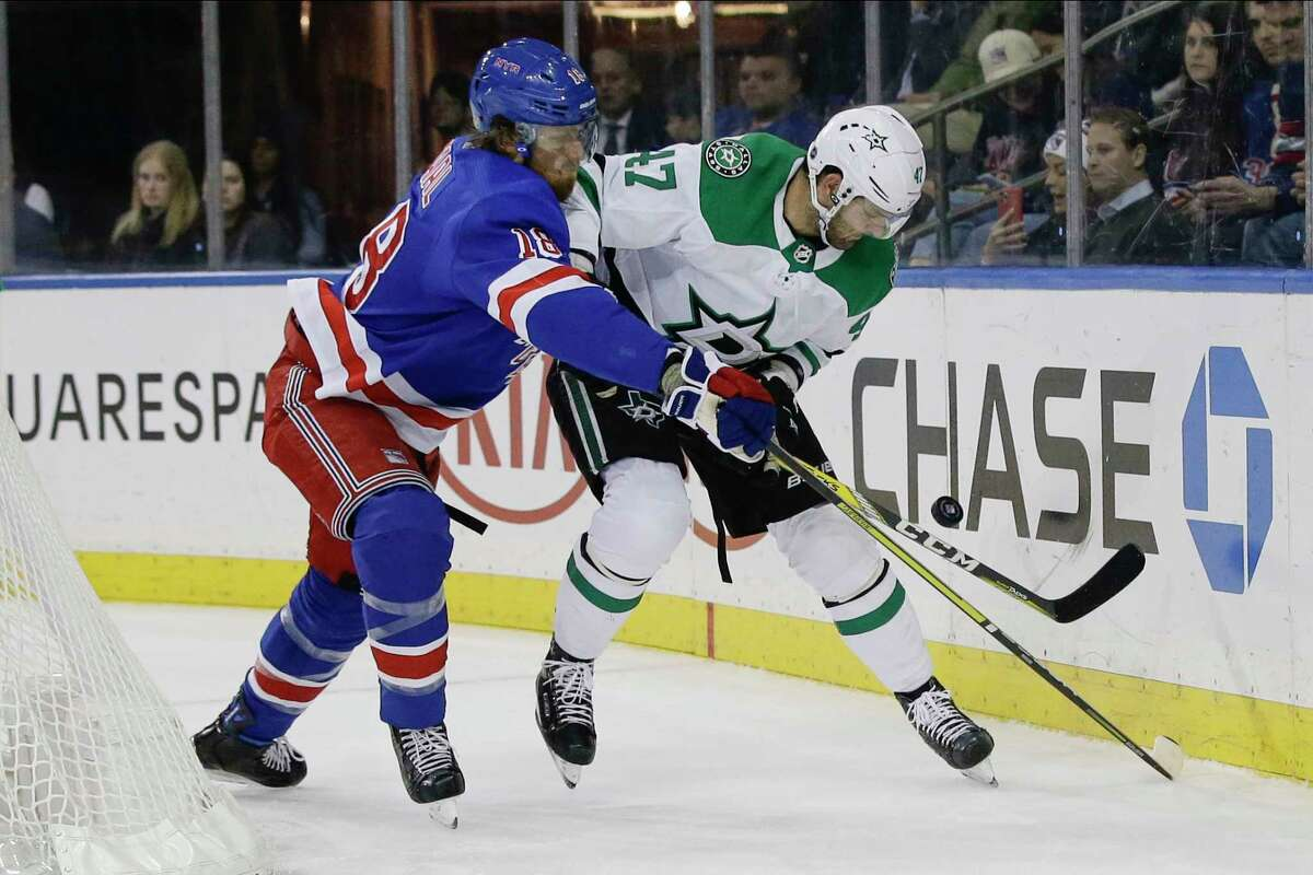 New York Rangers' Marc Staal (18) fights for control of the puck with Dallas Stars' Alexander Radulov (47) during the first period of an NHL hockey game Monday, Feb. 3, 2020, in New York. (AP Photo/Frank Franklin II)