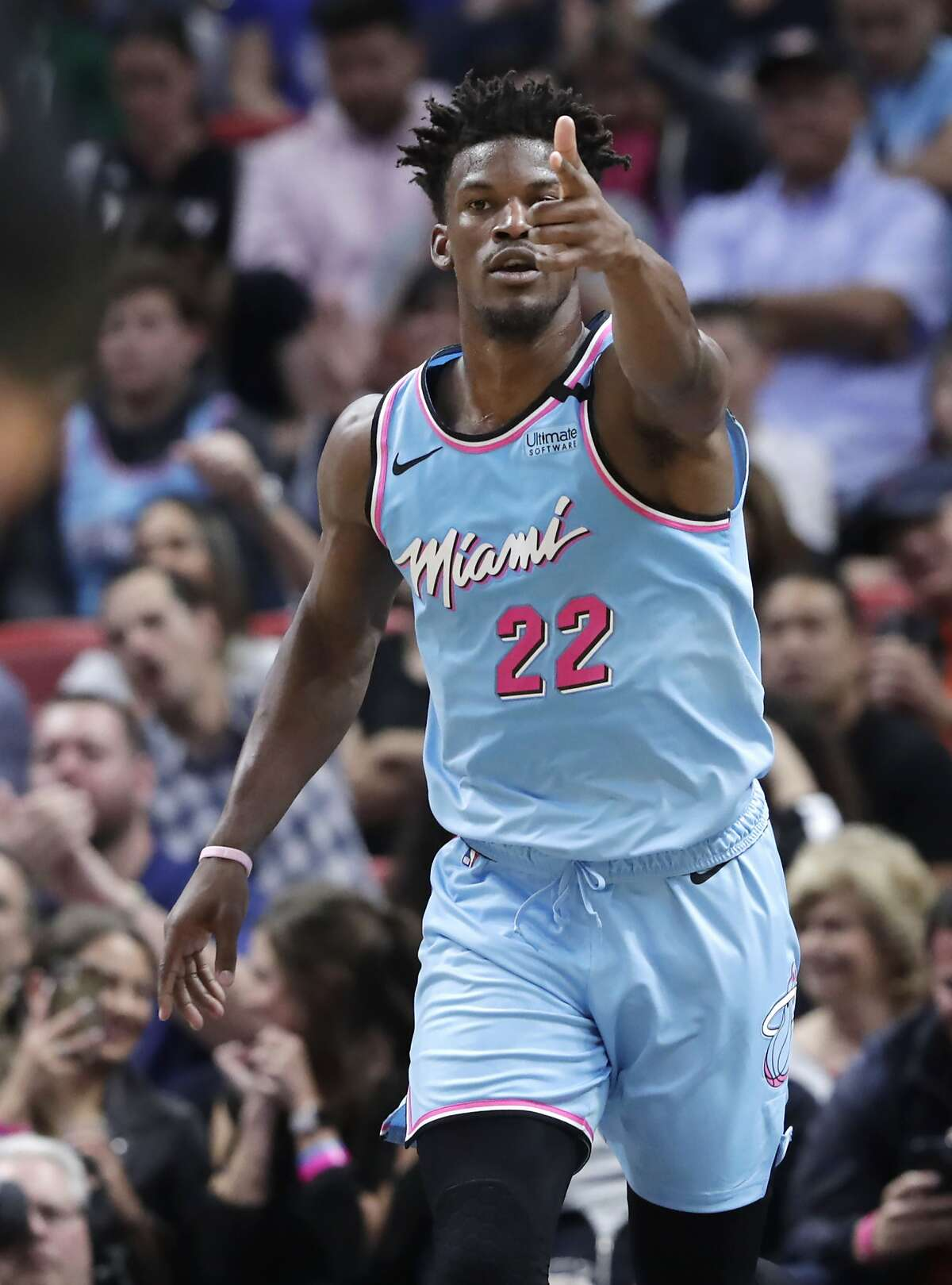 Miami Heat forward Jimmy Butler reacts after scoring during the first half of an NBA basketball game against the Philadelphia 76ers, Monday, Feb. 3, 2020, in Miami. (AP Photo/Lynne Sladky)