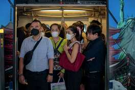 Commuters wear face masks to protect themselves from air pollution and the spreading coronavirus in Bangkok, Thailand, Tuesday, Feb. 4, 2020. On Tuesday, the Korea Centers for Disease Control and Prevention said a 42-year-old South Korean woman tested positive for the virus, days after she returned from a trip to Thailand with chills and other symptoms.