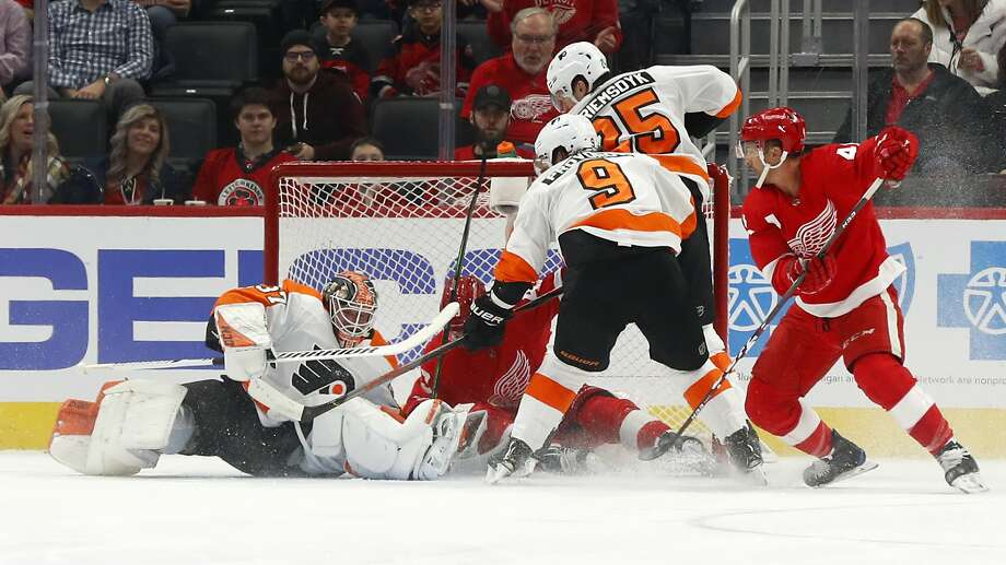 Philadelphia Flyers goaltender Brian Elliott (37) stops a Detroit Red Wings left wing Darren Helm (43) shot in the first period of an NHL hockey game Monday, Feb. 3, 2020, in Detroit. (AP Photo/Paul Sancya) Brian Elliott made 16 saves for his 40th career shutout in the Philadelphia Flyers' 3-0 win over the sinking Detroit Red Wings on Monday night. Photo: Paul Sancya / Associated Press