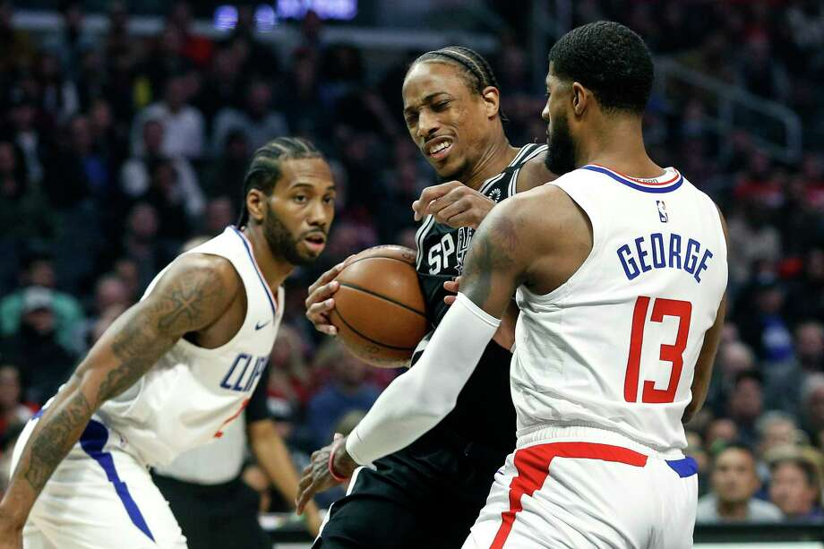 San Antonio Spurs' DeMar DeRozan, center, drives against Los Angeles Clippers' Paul George (13) during the first half of an NBA basketball game, Monday, Feb. 3, 2020, in Los Angeles. (AP Photo/Ringo H.W. Chiu) Photo: Ringo H.W. Chiu, FRE / Associated Press / Copyright 2020 Associated Press. All rights reserved.