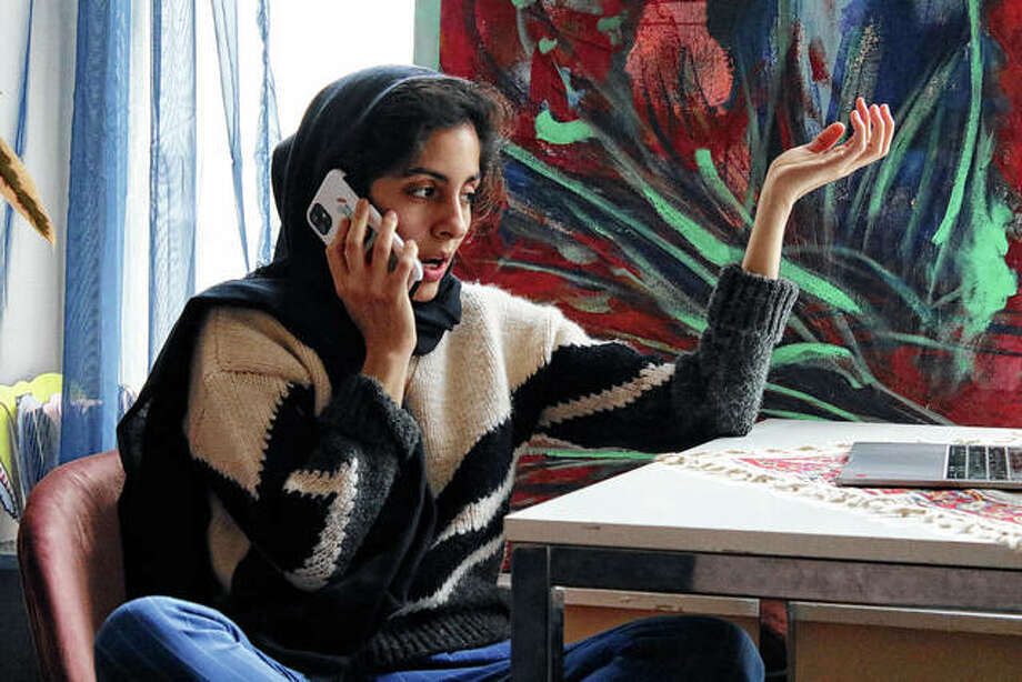 Iranian American activist Hoda Katebi, 25, speaks to another activist on Jan. 12 from her Chicago apartment. She and her network had received word that morning that an Iranian student was being detained at O'Hare International Airport. Photo: Noreen Nasir | Associated Press