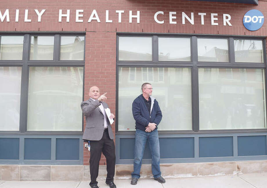 Matt Holt (left), Dot Foods' vice president of human resources, and Mount Sterling Mayor Matt Bradbury address those at the opening Monday of Dot Foods Mount Sterling Family Health Center. The facility will provide health services to Dot employees. Photo: Marco Cartolano | Journal-Courier