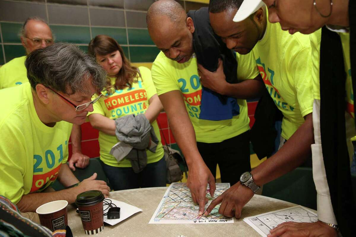 A team of volunteers study the map of the area they are going to cover for the annual Houston homeless count in 2017.