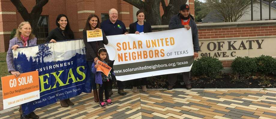 Advocates of solar energy met at Katy City Hall Jan. 30 to promote upcoming workshops on the alternative form of energy, From left are Dori Wolfe of Solar United Neighbors;?Jen Schmerling, deputy director, Environment Texas; parent Silva Sherman and her daughter Amalee; Norm Whitton, a Katy solar user; Hannah Mitchell, program director, Solar United Neighbors of Texas; and David Rosa of Houston Renewable Energy Group. Photo: Karen Zurawski/Staff Photo