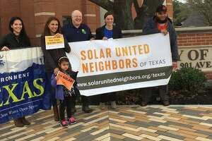 Advocates of solar energy met at Katy City Hall Jan. 30 to promote upcoming workshops on the alternative form of energy, From left are Dori Wolfe of Solar United Neighbors;Jen Schmerling, deputy director, Environment Texas; parent Silva Sherman and her daughter Amalee; Norm Whitton, a Katy solar user; Hannah Mitchell, program director, Solar United Neighbors of Texas; and David Rosa, solar energy specialist, Sun Pro Solar.