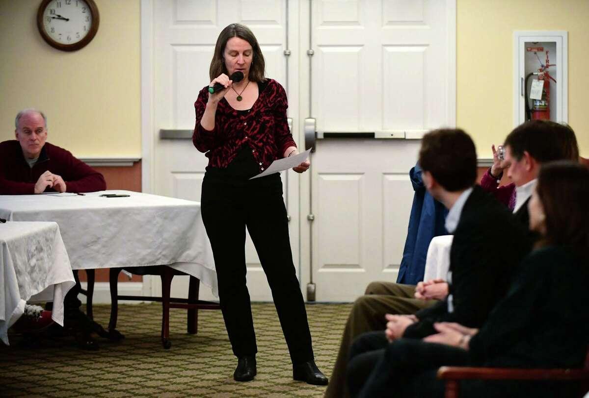 Voter service representative for the Wilton League of Women Voters Pam Klem asks a question of the panel of legislators.