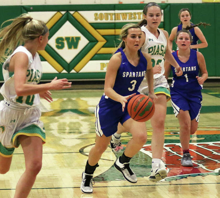 North Greene's Lakeleigh Brown (3) beats the press from Southwestern during a Nov. 20 game in Piasa. Brown, North Greene's all-time leading scorer, finished with 22 points Monday night in a Spartans victory over Greenfield in White Hall. Photo: Greg Shashack / The Telegraph