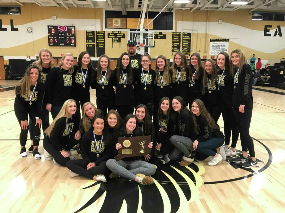 The Trumbull girls' volleyball team capped a tremendous run through the CIAC Class LL tournament with a 3-0 win over Westhill for its first state championship. That performance by coach Nicole Trommelen's Eagles propelled them to the top of the final Connecticut coaches state poll for 2019. The team was honored prior to a recent THS boys' basketball game. Tom Zultowski (javyee), Rachel Reid and Jennifer Marrone (freshmen) were assistant coaches. Team members include Kathryn Zanvettor, Kiley Barbagallo, Stephanie Olah, Amanda Sullivan, Bailey Cenatiempo, Natalie Onofreo, Jamie McPartland, Alina Goncalves, Maeve Hampford, Paige Corsi, Jessica Nyitrai, Callan Vaughn, Jamie Willix, Jacqueline Malheiro, Lindsay Gibbs, Ali Castro, Julia Larkin, Ashleigh Johnson, Maggie Carley and Mia Egmont. Photo: Contributed Photo / Trumbull High Athletics / Trumbull Times