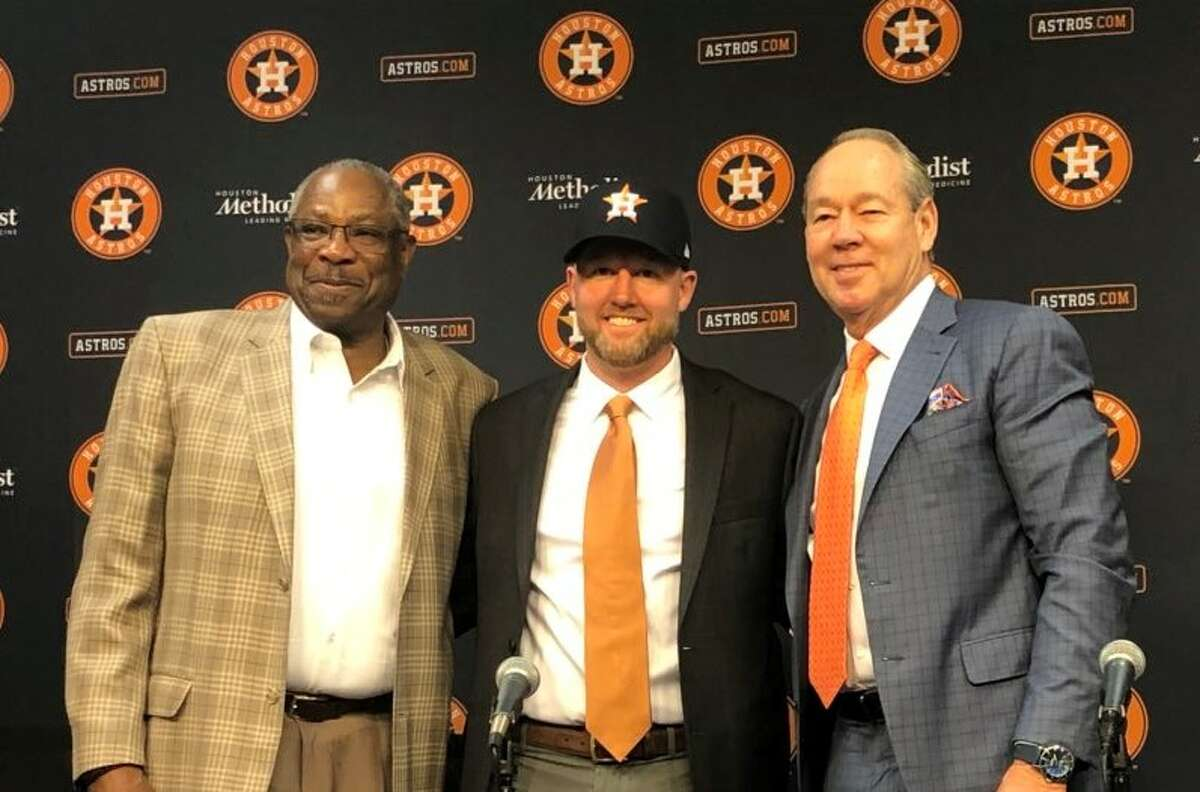 New Houston Astros general manager James Click (center) at his introductory press conference with manager Dusty Baker and owner Jim Crane on Tuesday, Feb. 4, 2020 at Minute Maid Park.