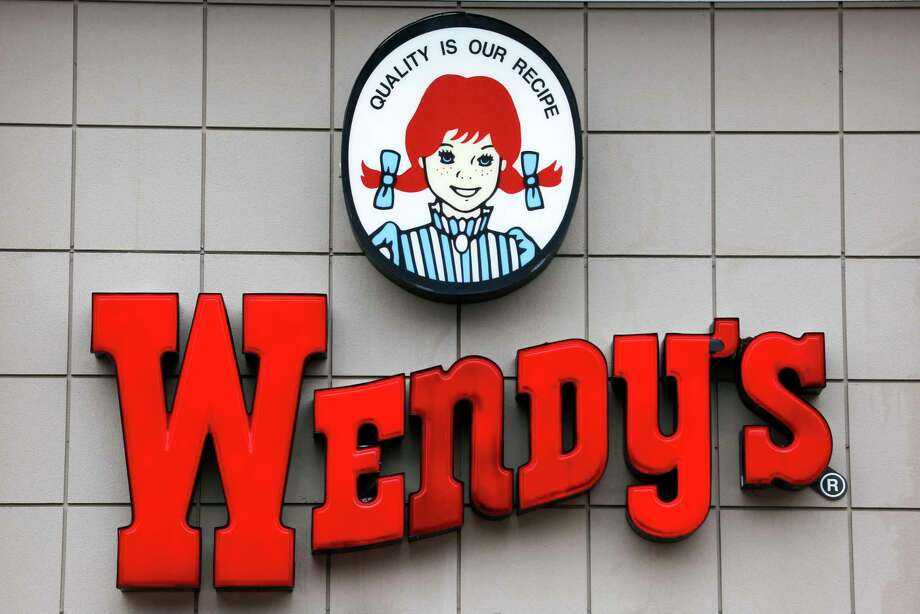 FILE- This Feb. 23, 2018, file photo shows a Wendy's restaurant in Pittsburgh. Wendy's said Monday, Sept. 10, 2019 it's relaunching breakfast across the U.S. next year, the latest fast-food chain to amp up its offerings as more consumers eat out in the morning. (AP Photo/Gene J. Puskar, File) Photo: Gene J. Puskar / Associated Press / Copyright 2018 The Associated Press. All rights reserved.