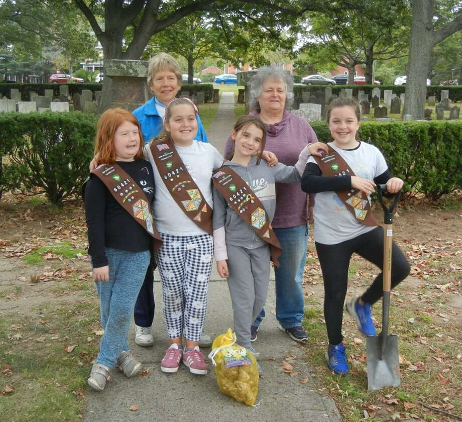 Brownies Evelyn, Ava, Kylie, and Abby, and Daytime Gardeners Sally Brockett and Barbara Feinberg are ready to plant bulbs. Photo: Contributed Photo /