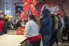 Chicken finger fans make the first orders 02/04/20 morning at the grand opening of Midland's Raising Cane's. Tim Fischer/Reporter-Telegram