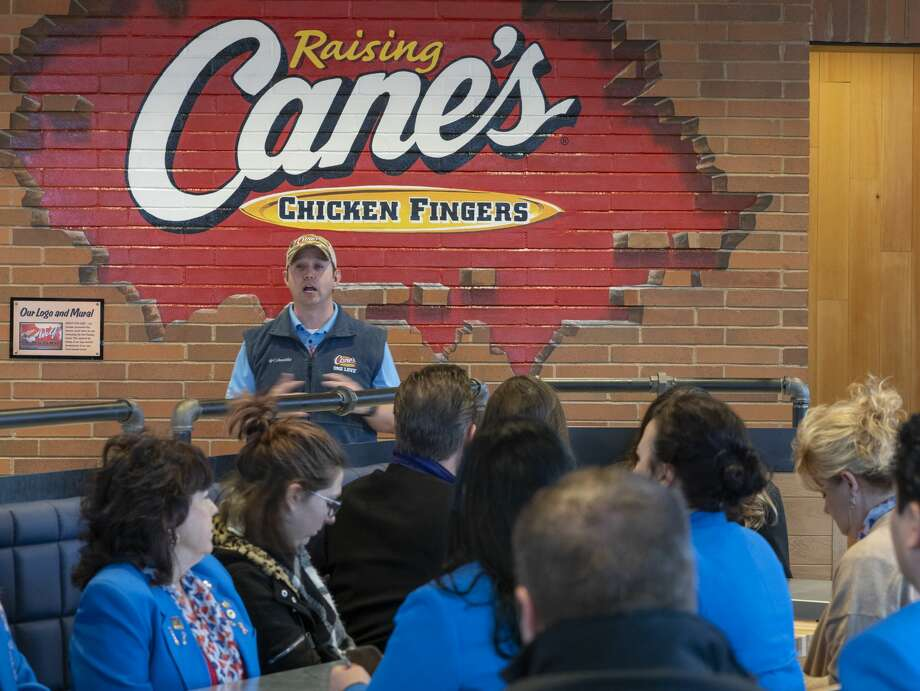 Mike Spano, area leader of restaurants for Raising Cane's, tells about the history of the restaurant 02/04/20 morning at the grand opening of Midland's Raising Cane's. Tim Fischer/Reporter-Telegram Photo: Tim Fischer/Midland Reporter-Telegram